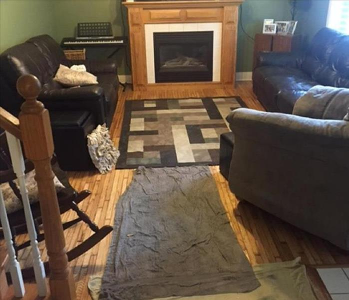 picture of a living room with hardwood, couches, fireplace