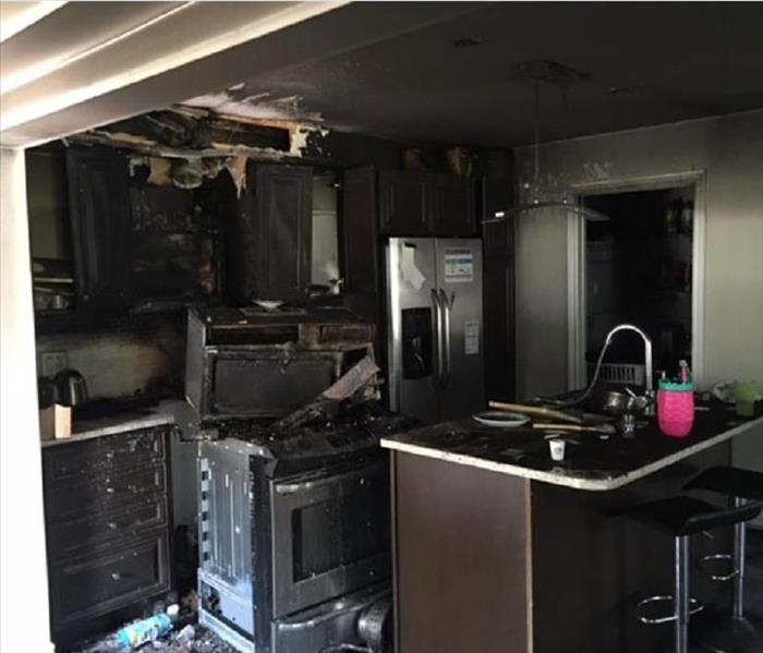kitchen cabinets and appliances are burnt