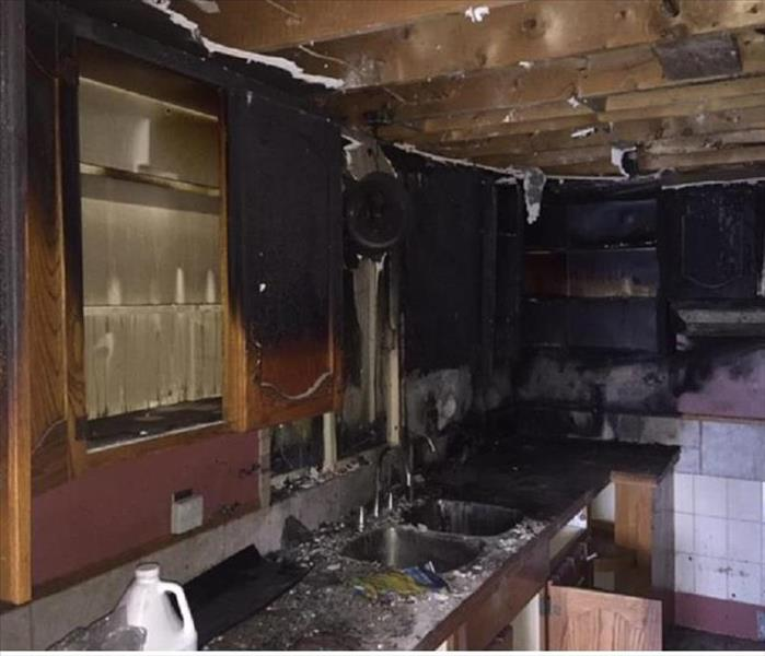 kitchen with burnt cabinets from fire