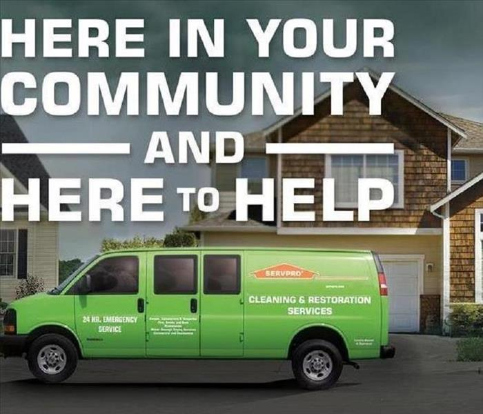 A SERVPRO vehicle with a message that says here in your community and here to help