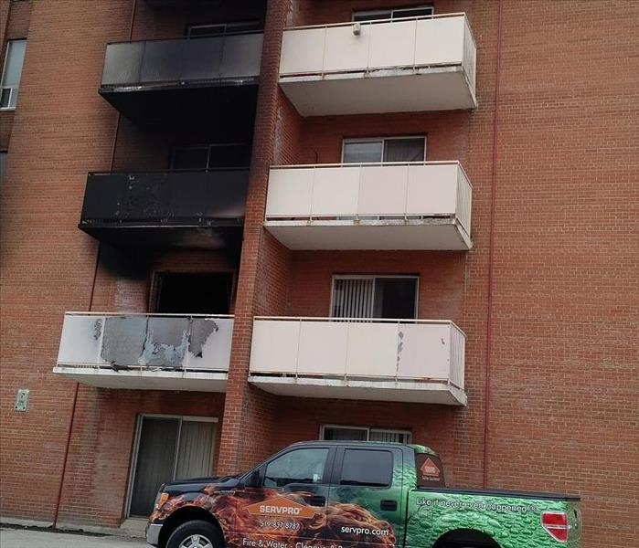 Apartment building with fire damage to the brick and exterior
