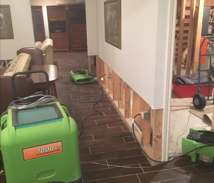 Basement tile floor, SERVPRO drying equipment and drywall removed at 2 feet