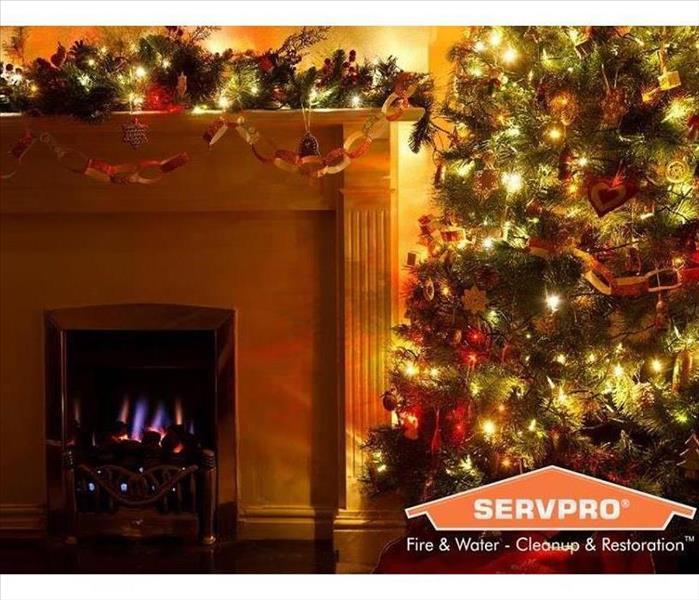 Picture of a Christmas Tree and Fireplace with a SERVPRO logo in right corner