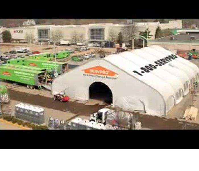 large mall with SERVPRO vehicles in the parking lot, as well a large tent