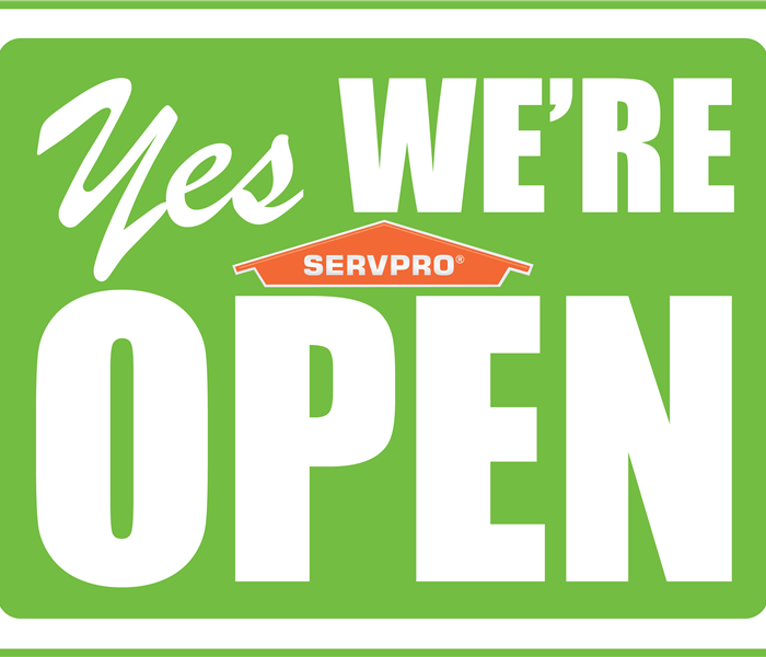 SERVPRO logo sign saying yes were open